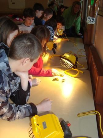 Students learn how solar panels work by making observations while playing with solar toys.